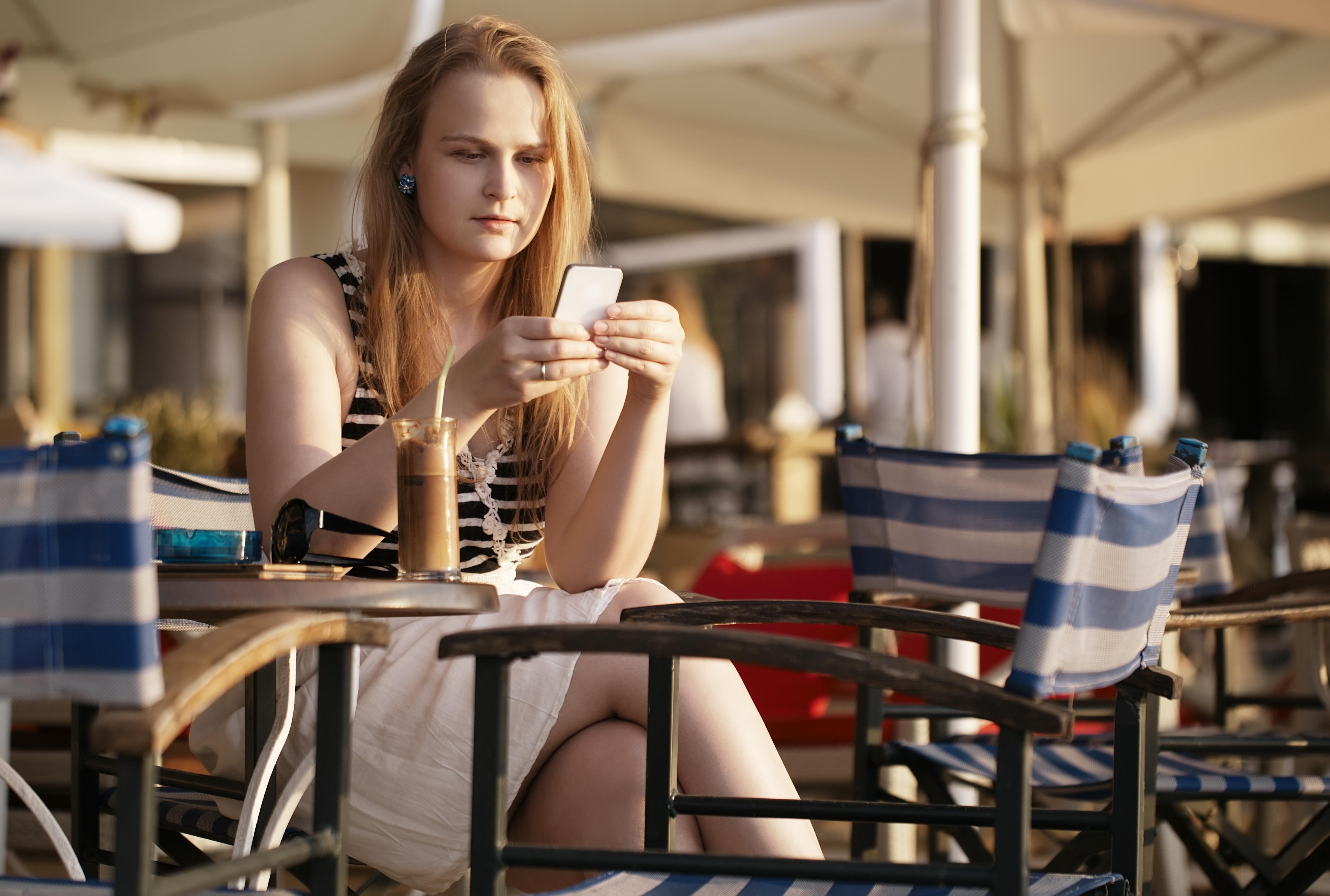 girl-on-phone-restaurant_top-guest-wifi-concerns.jpg